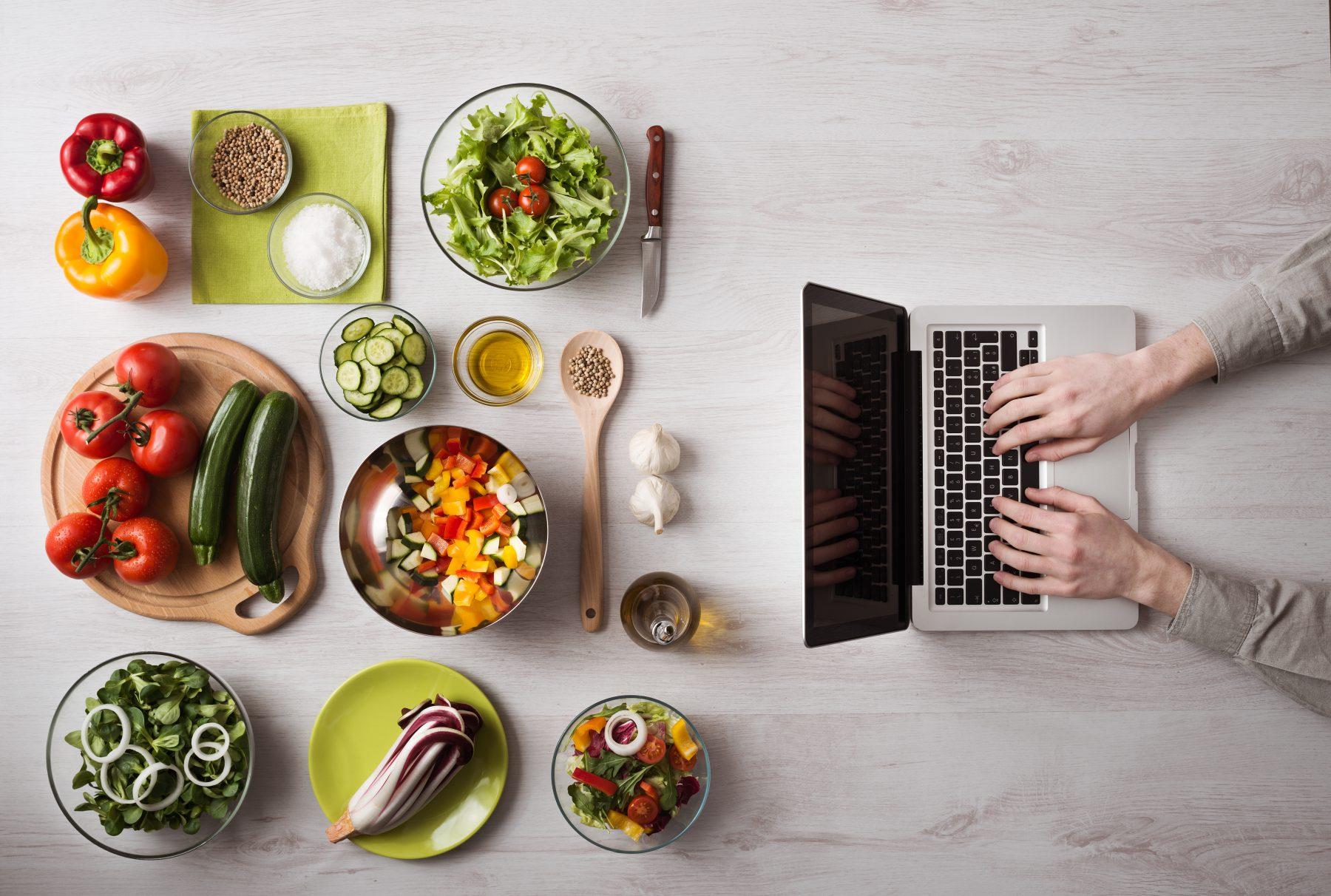 large - table veggies man hand laptop